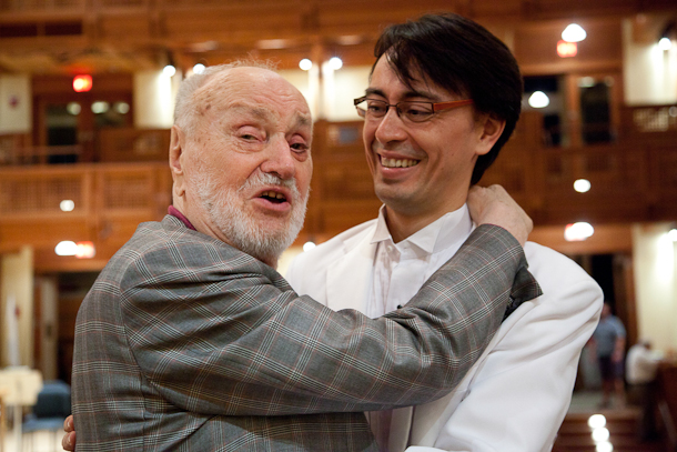"Festival of Contemporary Music Tanglewood Conductor Kurt Masur gives his son Ken- David Masur a congratulatory hug after the younger Masur conducted  "" In Summer"" as part of the Festival  ©Michael J. Lutch for The new York Times"
